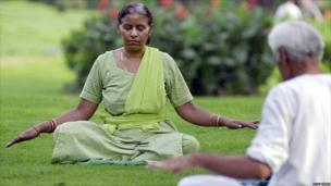 People practice yoga in a Delhi park