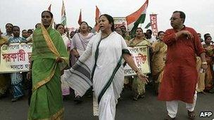 Mamata Banerjee leading his supporters