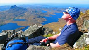 Jeff Hattie asleep on Creag nan Calman with Stac Pollaidh in the background