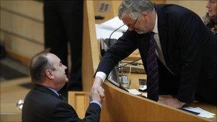 Alex Salmond shakes hands with outgoing presiding officer Alex Fergusson