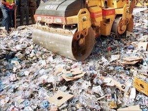 Steamroller destroying pirated DVDs, AP