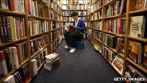 man sat in bookshop