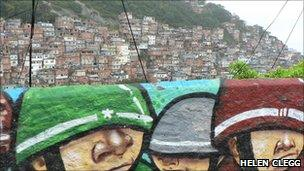 A mural and a view of the favela