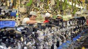 Factory workers assemble Nissan's VQ engines at the Iwaki engine plant in Iwaki, Fukushima prefecture, on May 17, 2011.
