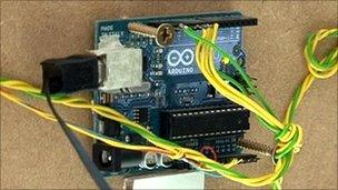 Arduino microcontroller attached to the back of the Project A Sketch machine