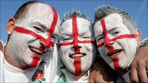 Rugby fans with faces painted in colours of St George's Cross