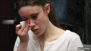 Casey Anthony wipes away tears
