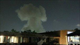 Smoke rises over buildings in Tripoli, Libya (24 May 2011)