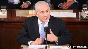 Israeli Prime Minister Benjamin Netanyahu (C) addresses a joint meeting of the U.S. Congress as U.S