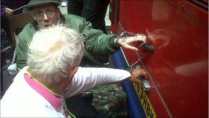 Wheelchair users handcuffed to a bus