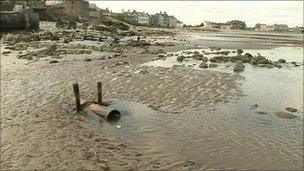 Outlet pipe on beach