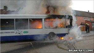 Firefighters tackling bus fire - Brian Ratcliffe