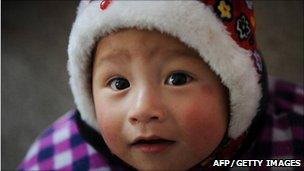 Picture of a Chinese child wearing a hat