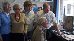 People being shown special technology at Support 4 Sight in Saffron Walden