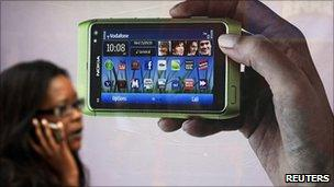 Shopper walking past Nokia advert