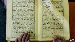 Student reads the Koran