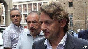 Giuseppe Signori (left, foreground) leaves police station in Bologna, Italy
