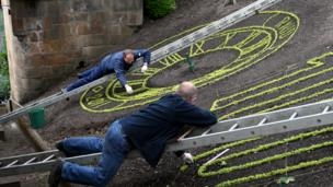 Men planting flowers in Princes Street Gardens