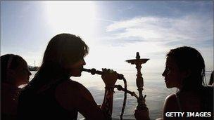 Young women smoking hookahs (generic image)
