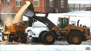 A digger fills a truck with rock salt at Winsford Rock Salt Mine