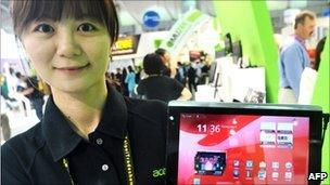 Woman holding Acer tablet