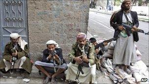 Armed tribesmen loyal to Sheikh Sadeq al-Ahmar, the head of the powerful Hashid tribe, take positions near his house in Sanaa, Yemen, 26 May 2011