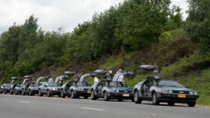 De Lorean cars parked in a row