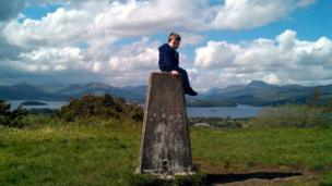 Luke sitting on a pillar at Duncryne