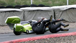 Sidecar racer and passenger on the track after coming off their bike