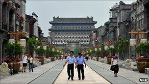 Visitors walk down the once historical Qianmen Street in one of Beijing's oldest neighbourhoods which has now been turned into a tourist attraction