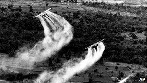 US Air Force planes spray Agent Orange over dense vegetation in South Vietnam, 1966