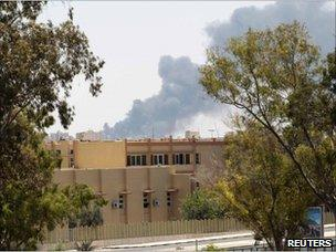 Smoke rises from buildings in Tripoli after Nato air strikes (17 June 2011)