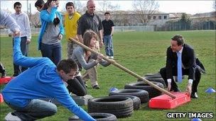 David Cameron and teenagers on a team-building course (April 2010)