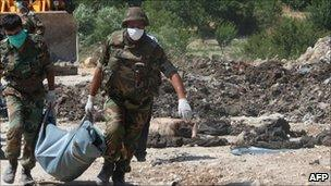 Government facility to a mass grave near Jisr al-Shughour allegedly containing the corpses of eight soldiers - 26 June