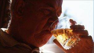 Elderly man drinking