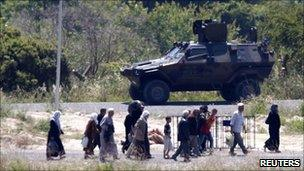 Syrian refugees enter the Turkish side of the border on 23 June 2011