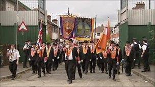 orangemen pass through peaceline on Workman avenue in west Belfast