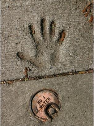 A hand print in concrete