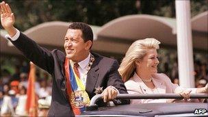 Hugo Chavez and wife Marisabel Rodriguez de Chavez in open-top motorcade