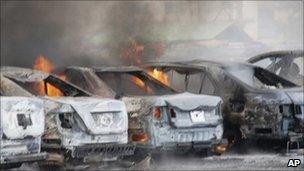 Burning vehicles in police HQ car park