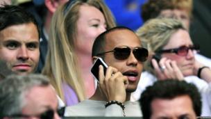Lewis Hamilton on his mobile phone