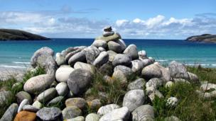 Cairn on Vatersay with sea in the background