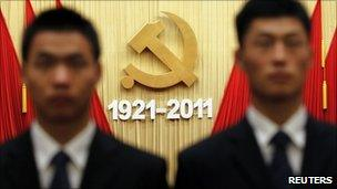 Security officers stand guard after the celebration of the 90th anniversary of the founding of Communist Party of China (CPC), at the Great Hall of the People in Beijing July 1, 2011