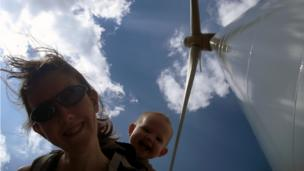 Amy and Jocelyn beside a wind turbine