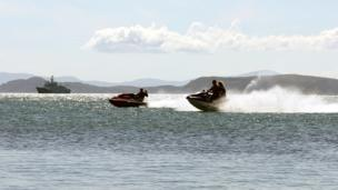 People on jet skis off Braighe on the Isle of Lewis