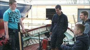 Coleg Llandrillo Cymru students working on the harbour launch Emma