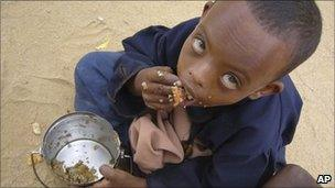In this file photo of Thursday June 26, 2009, A Somali child eats as he is waiting to be registered at UN. registration centre in Dagahaley, Northeastern Kenya