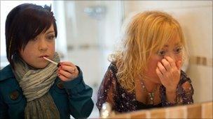 Jazz and her mum Bev putting on make-up