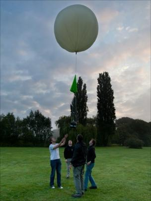 The team launching their meteorological weather balloon.