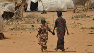 Children walk to registration centre in Dadaab